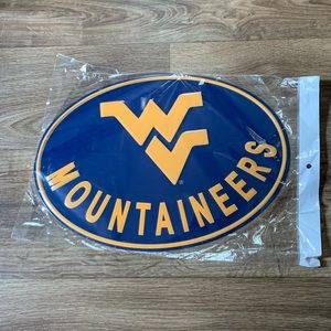 An oval WV Mountaineers metal sign unopened